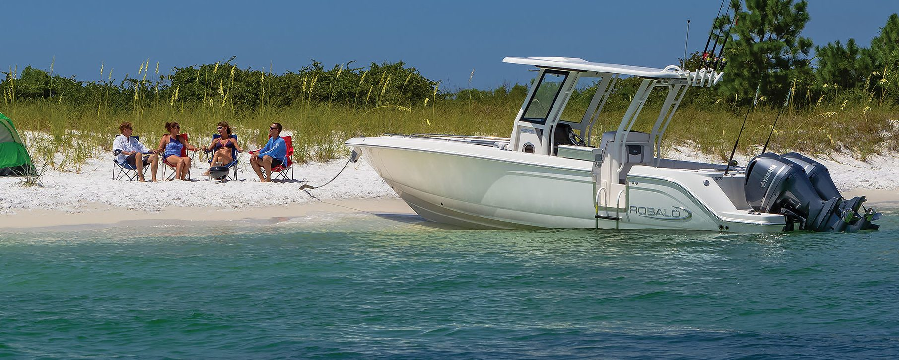 hanging out on shore alongside beached robalo center console